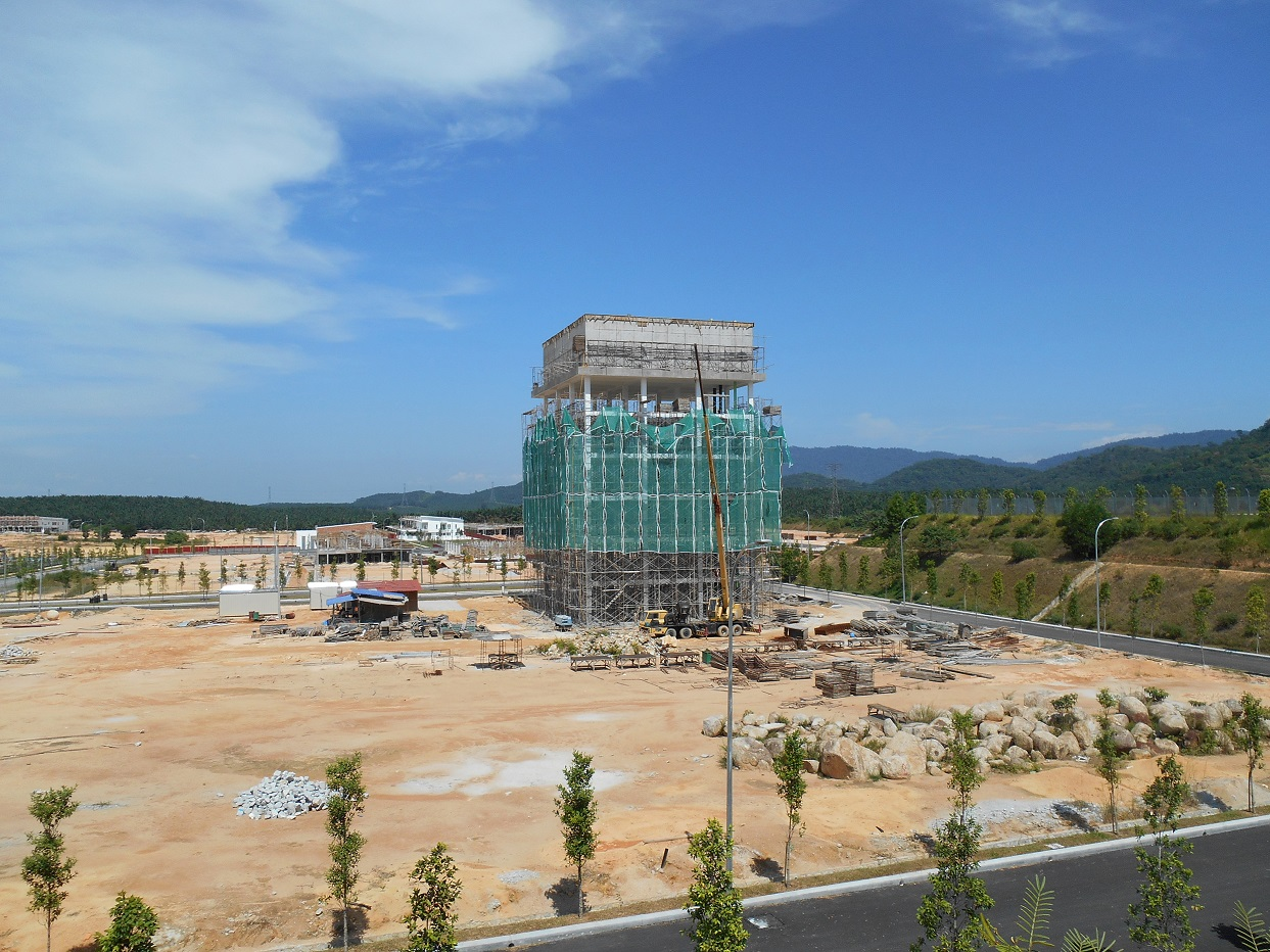 Construction of a new commercial building with initial commercial landscaping shown